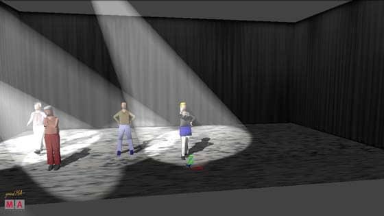 Ein Lichtkegel fällt mit dem Licht auf die Vordere Bühnenkante.